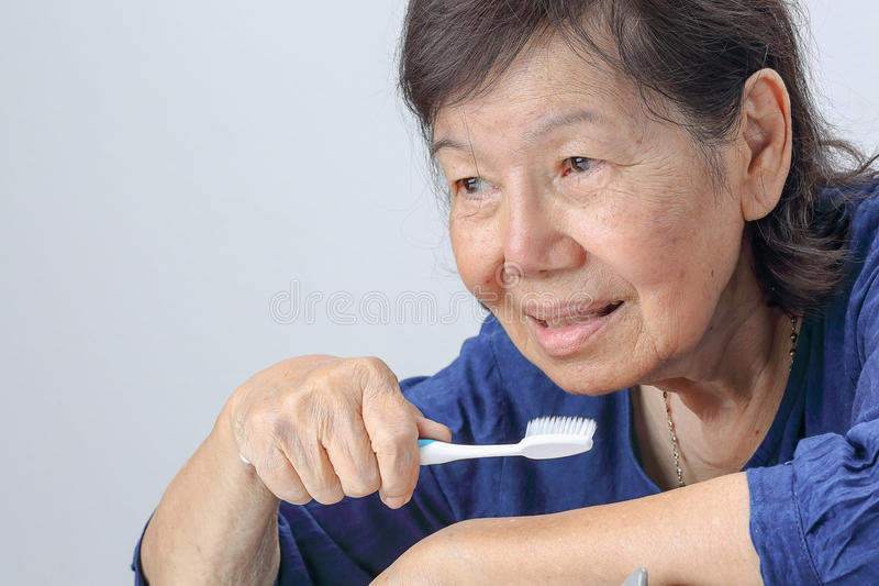 Asian elderly woman with a toothbrush. royalty free stock photos