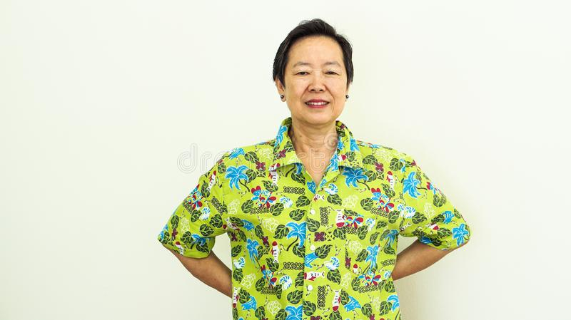 Asian elderly woman in vacation Hawaii shirt ready for travel holiday stock images