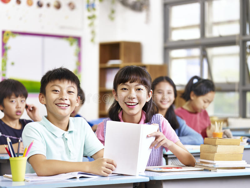 Asian elementary school students in classroom royalty free stock images