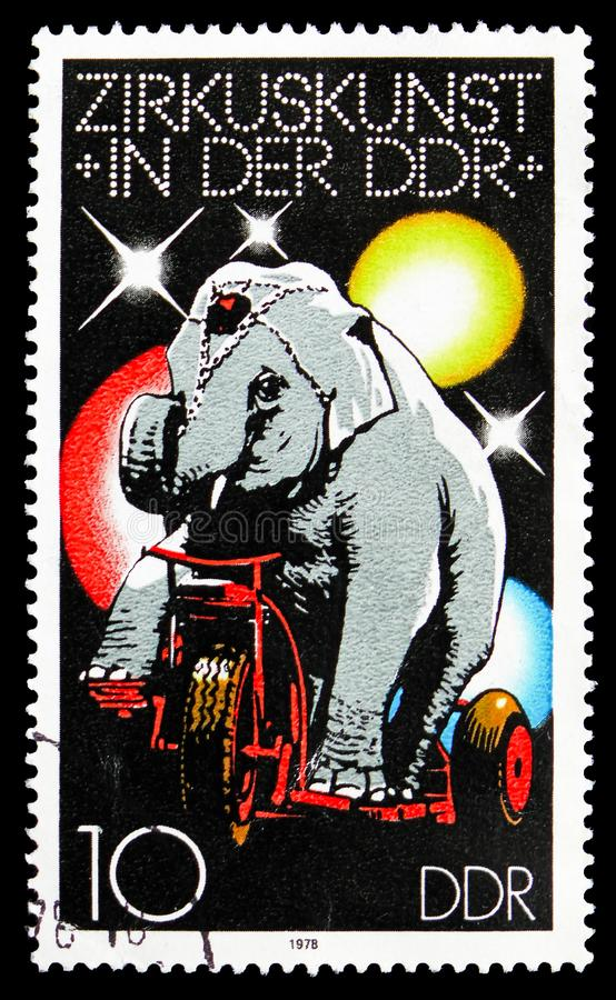 Asian Elephant (Elephus maximus) on Tricycle, Circus serie, circa 1978. MOSCOW, RUSSIA - SEPTEMBER 15, 2018: A stamp printed in DDR (Germany) shows Asian stock images
