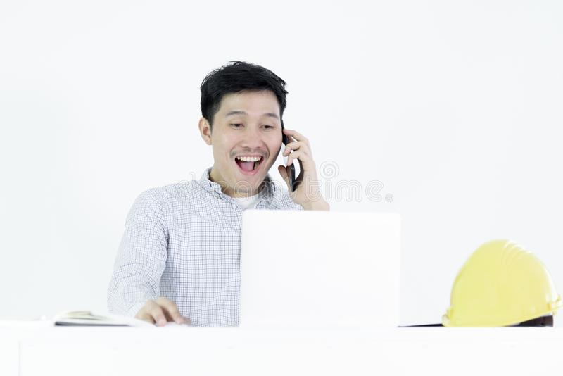 Asian employee engineer salary man sitting at desk and talking with phone, isolated on white background. Adult black blue book business businessman celebration stock images