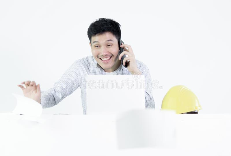 Asian employee engineer salary man sitting at desk throwing papers with feeling angry and upset, isolated on white background. Aggressive attitude black blue royalty free stock photos