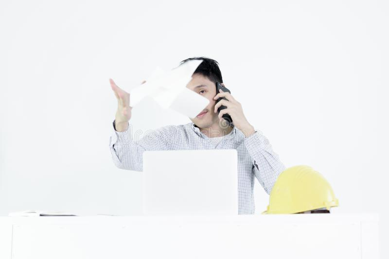 Asian employee engineer salary man sitting at desk throwing papers with feeling angry and upset, isolated on white background. Aggressive attitude black blue stock photos