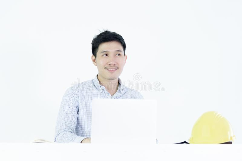 Asian employee engineer salary man sitting at desk and working with lazy and sleepy, isolated on white background. Adult black blue book boring business stock photo