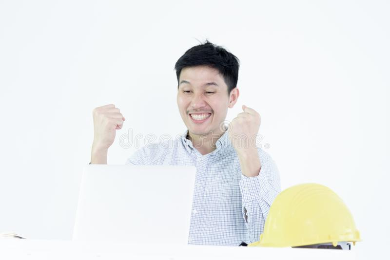 Asian employee engineer salary man sitting at desk and working w royalty free stock photography