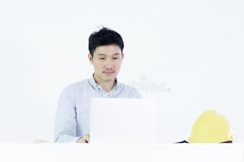 Asian employee engineer salary man sitting at desk and working w royalty free stock photo