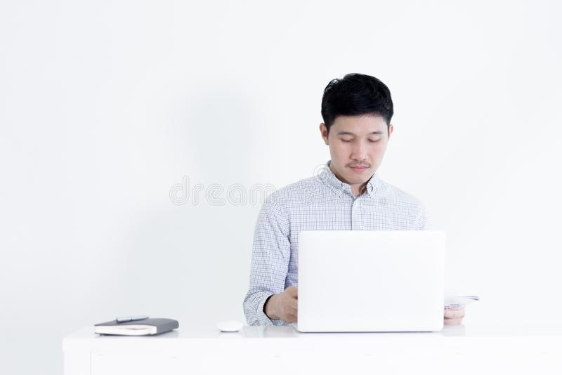 Asian employee man sitting at desk and working with copy space,. Isolated on white background stock photos