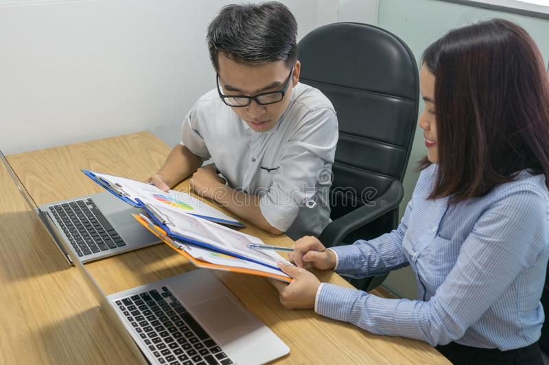 Asian employee reading financial number on report royalty free stock photos
