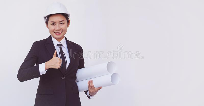 Asian engineer girl show thumbs up on white background royalty free stock photography