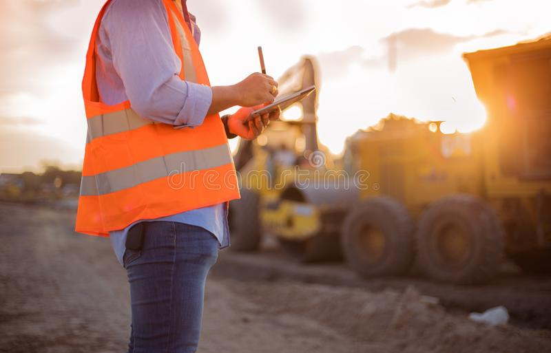 Asian engineer with hardhat using tablet pc computer inspecting stock images