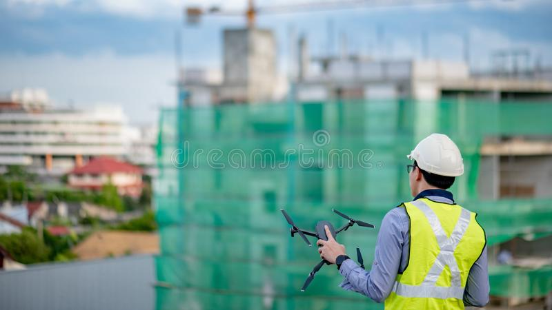 Asian engineer man using drone for site survey royalty free stock photography