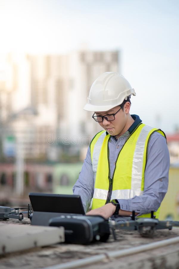 Asian engineer man using drone for site survey stock photo