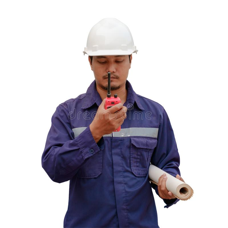 Asian engineer in safety uniform and white helmet holding project plan and walkie-talkie isolated on white background stock photo