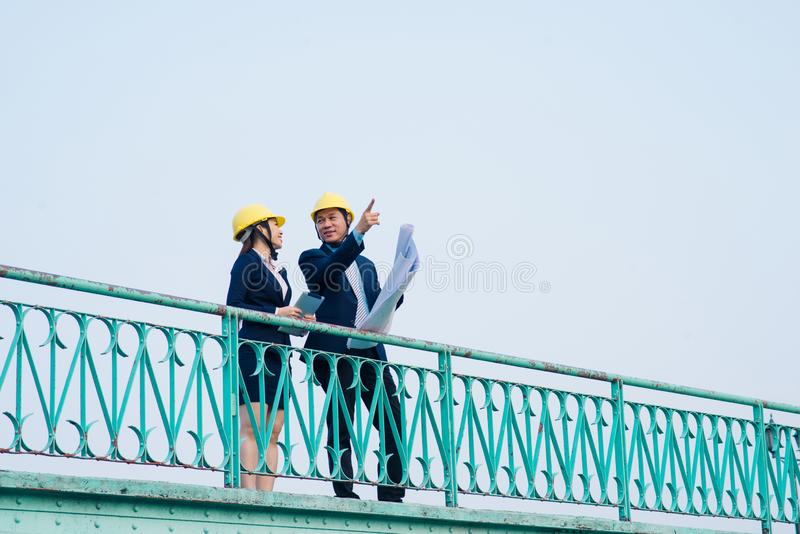 Asian engineer was acting with his secretary on the Business building background royalty free stock photos