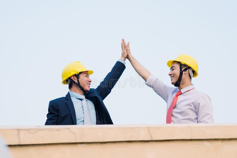 Asian engineer was acting with his secretary on the Business building background stock photography
