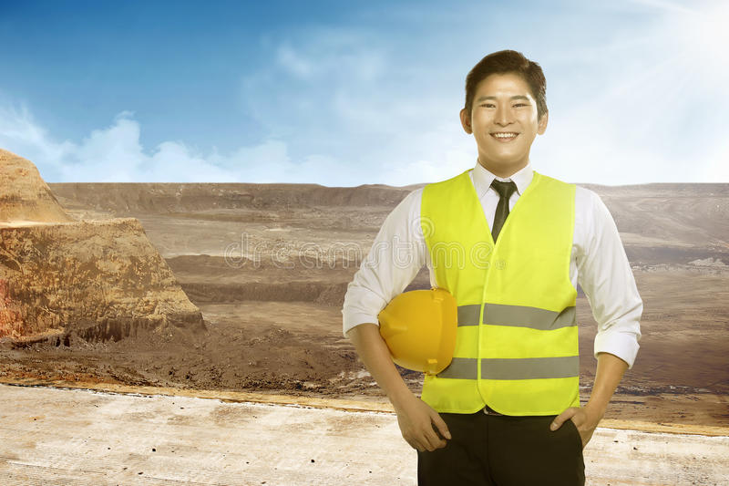 Asian engineer wearing safety vest. Industrial concept stock images