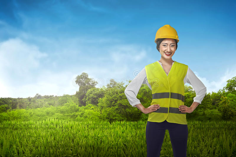 Asian engineer wearing safety vest. Industrial concept royalty free stock photography