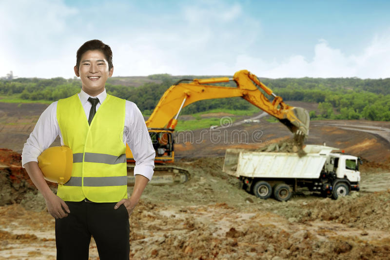 Asian engineer wearing safety vest. Industrial concept stock image
