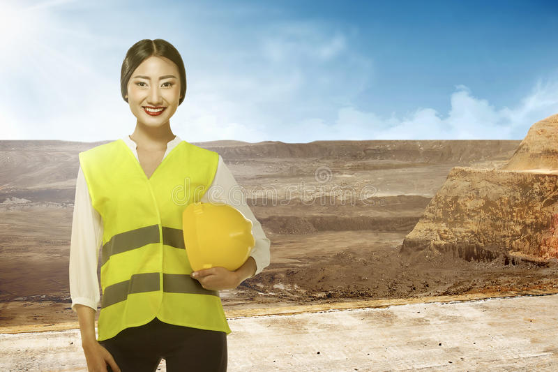 Asian engineer wearing safety vest. Industrial concept stock photos