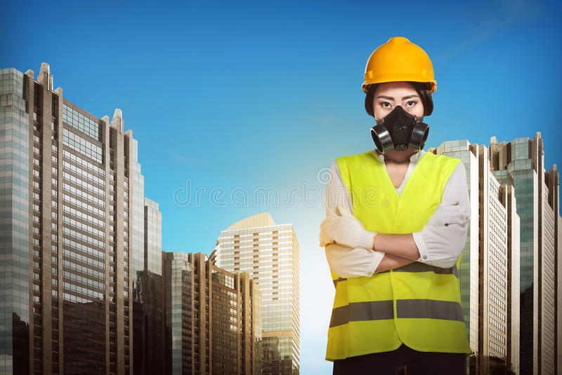 Asian engineer wearing safety vest. Industrial concept stock photography