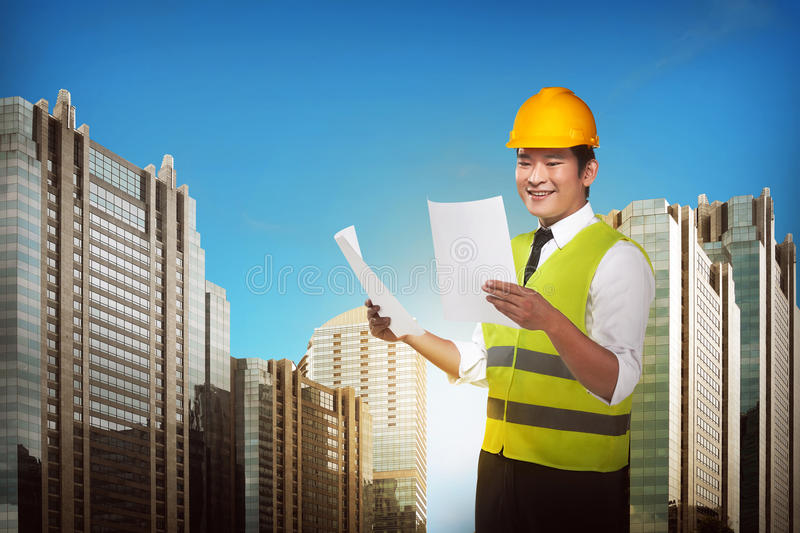Asian engineer wearing safety vest. Industrial concept royalty free stock images