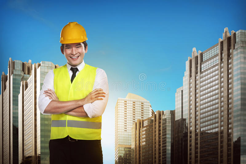 Asian engineer wearing safety vest. Industrial concept royalty free stock photos