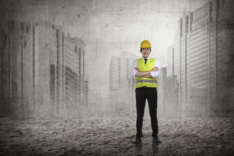 Asian engineer wearing safety vest. Industrial concept royalty free stock image
