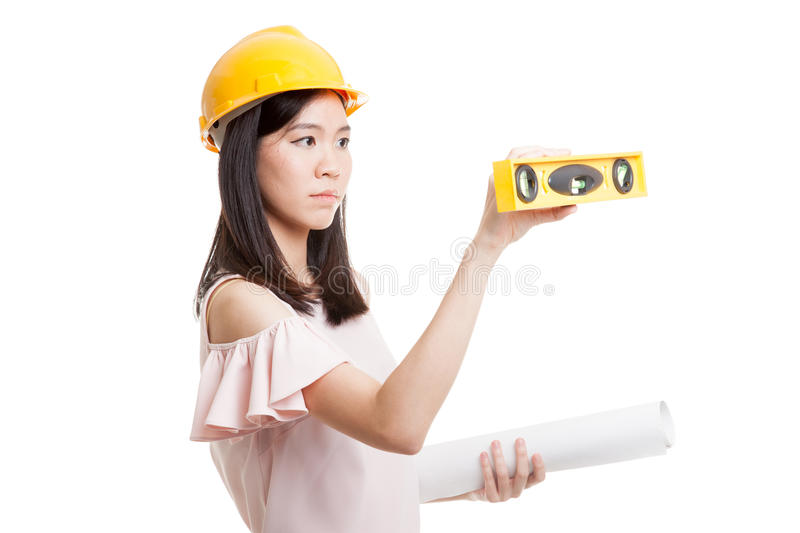 Asian engineer woman with blueprints and level. Asian engineer woman with blueprints and level isolated on white background royalty free stock photos