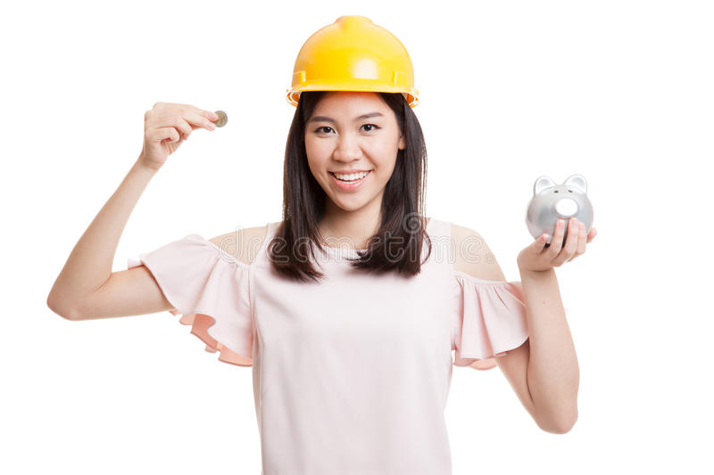 Asian engineer woman with a coin and piggy coin bank. Asian engineer woman with a coin and piggy coin bank isolated on white background stock photos