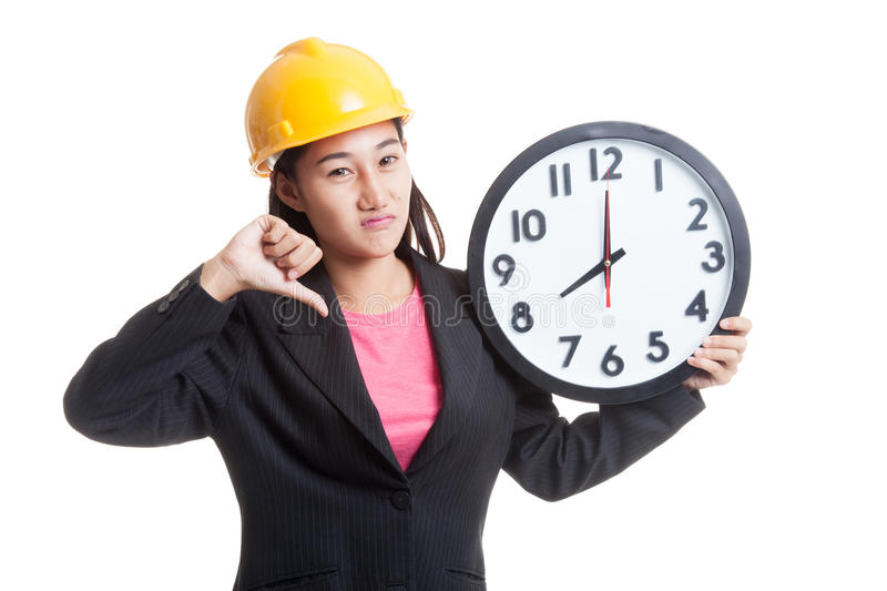 Asian engineer woman thumbs down with a clock. Asian engineer woman thumbs down with a clock isolated on white background stock images