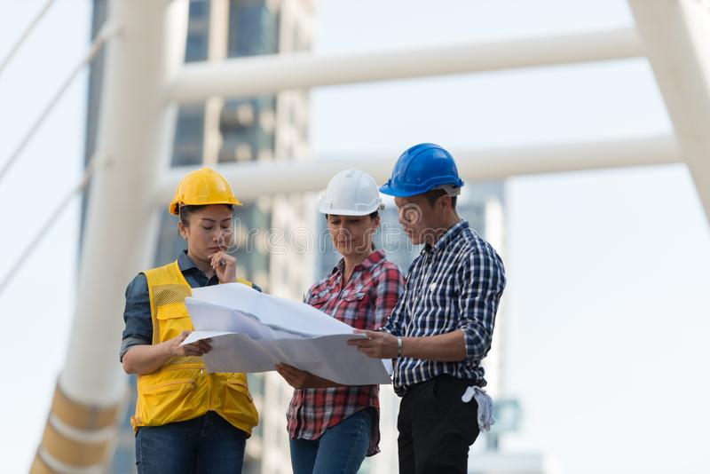 Asian engineers group consult construction on site building work download asian engineers group consult construction on site building work stock image image of group malvernweather Images