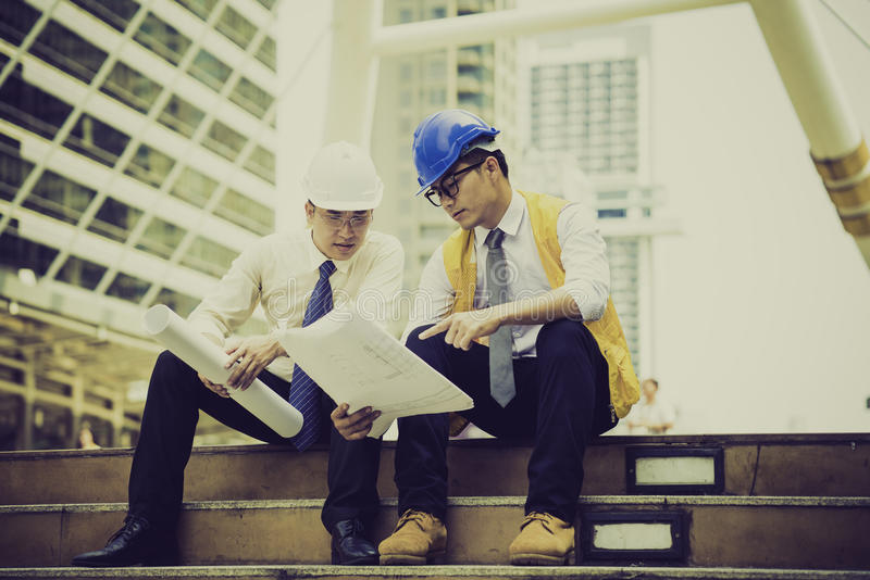 Asian engineers were consulted together and plan royalty free stock image