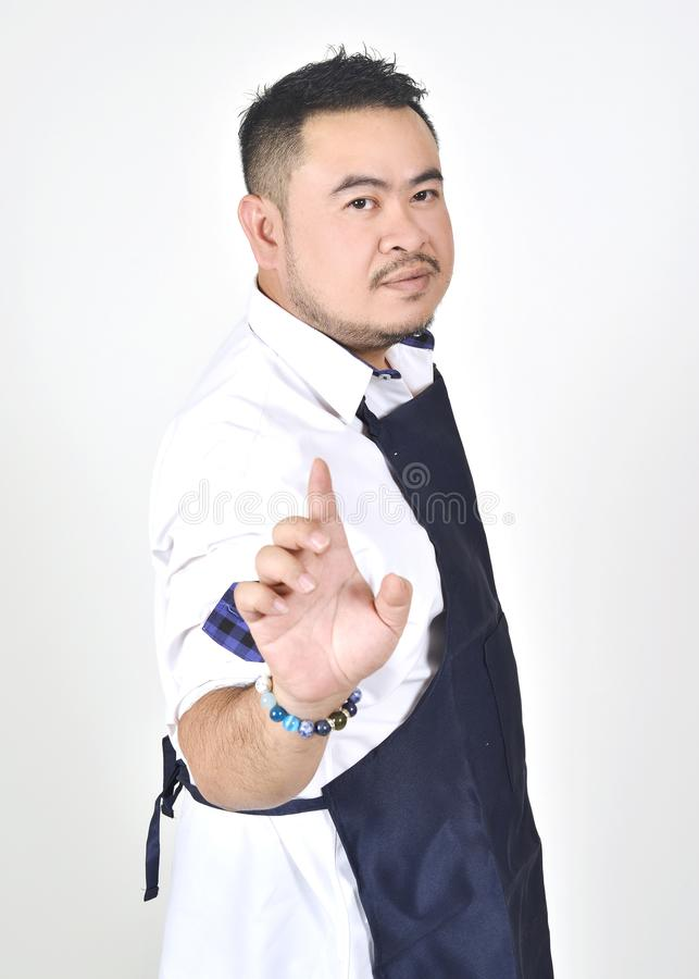 Asian entrepreneur fat man touching an imaginary button virtual screen standing. On white background royalty free stock photography