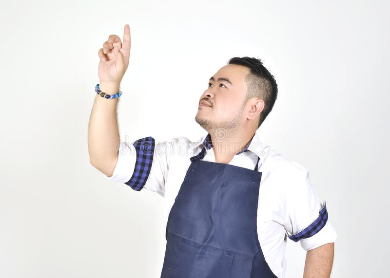 Asian entrepreneur fat man touching an imaginary button virtual screen standing. On white background stock photography