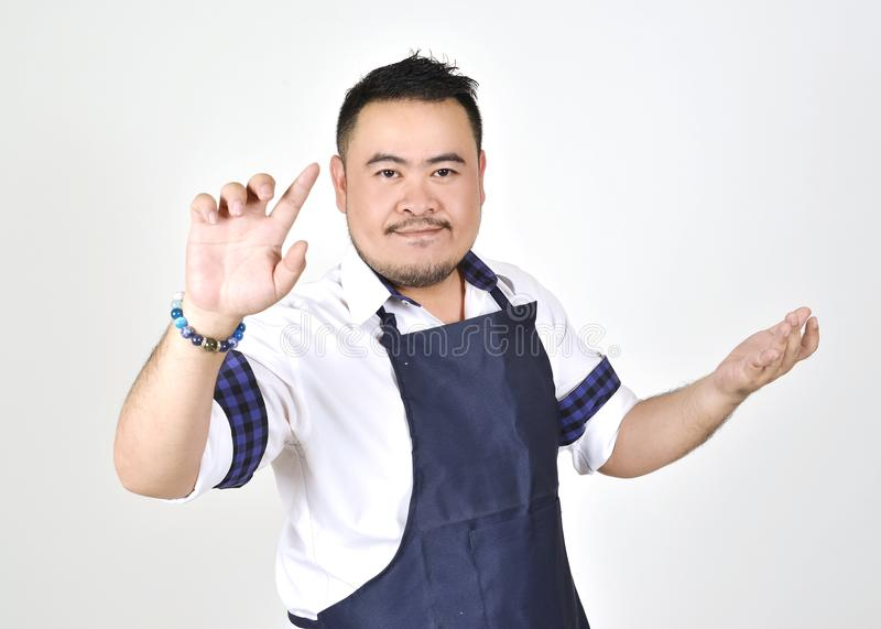 Asian entrepreneur fat man touching an imaginary button virtual screen standing. On white background royalty free stock photo