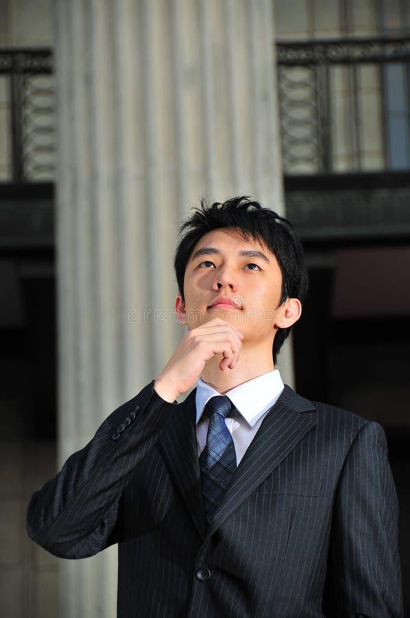 Asian Executive pondering stock photo