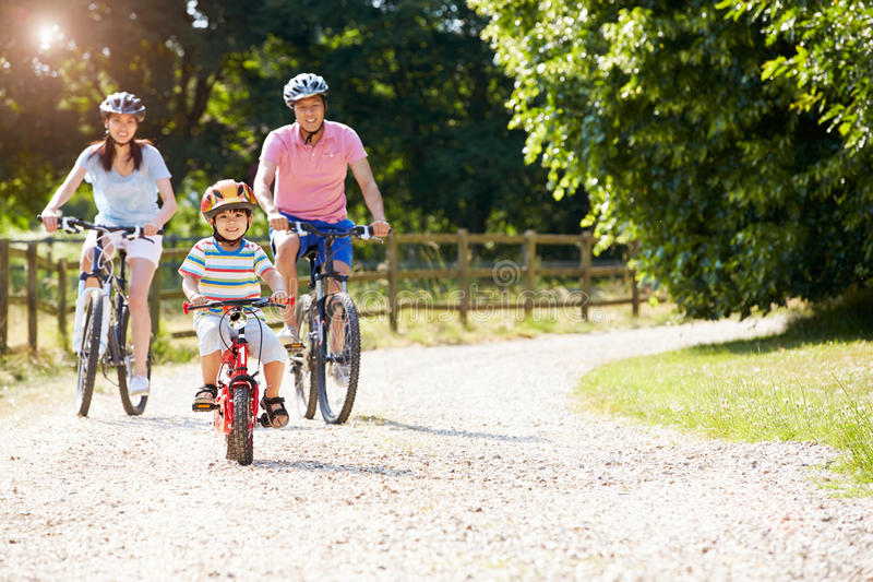 Asian Family On Cycle Ride In Countryside stock photography