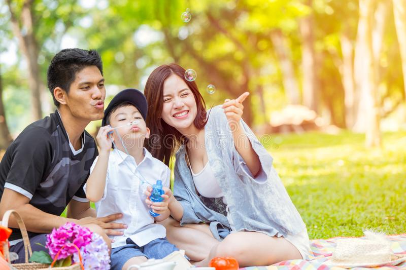 Asian Family enojy together at green park holiday vacation stock image
