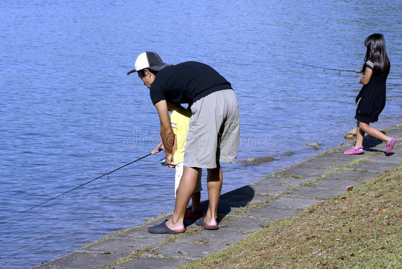 Asian family fishing stock images