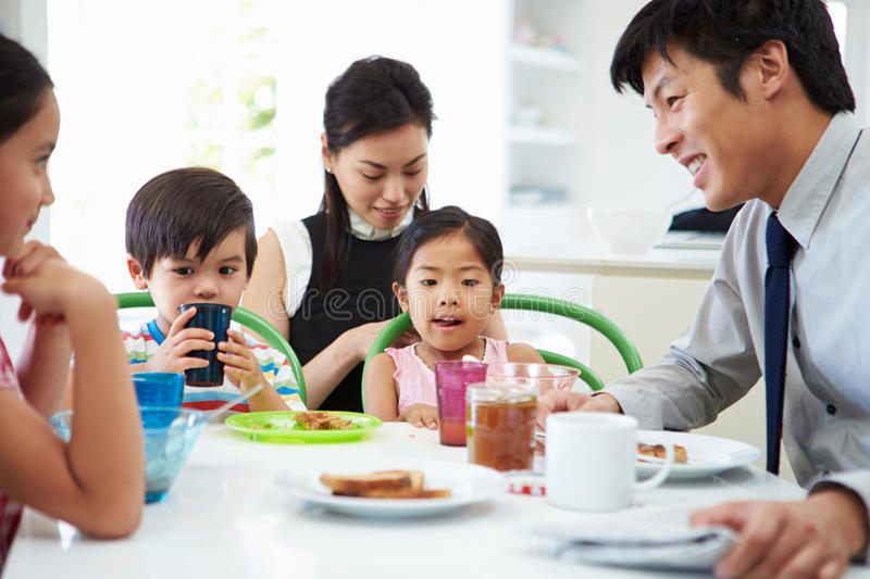 Asian Family Having Breakfast Before Husband Goes To Work. Sitting At Table royalty free stock photo
