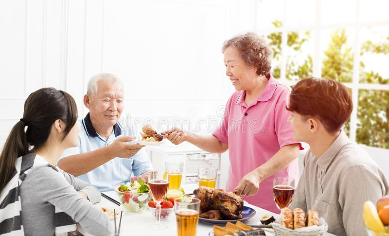 Asian family having dinner together royalty free stock photography