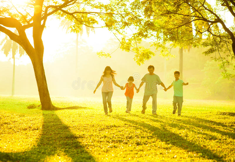 Asian family holding hands running royalty free stock photos