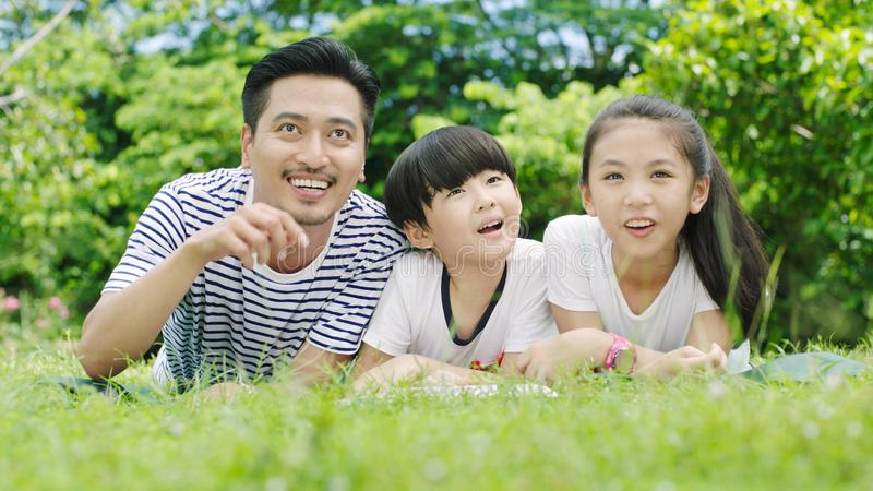 Asian family looking up royalty free stock photography
