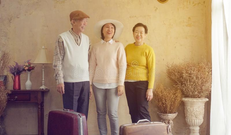Asian family mature daughter travel with senior parents to Europe luxury resort stock photography