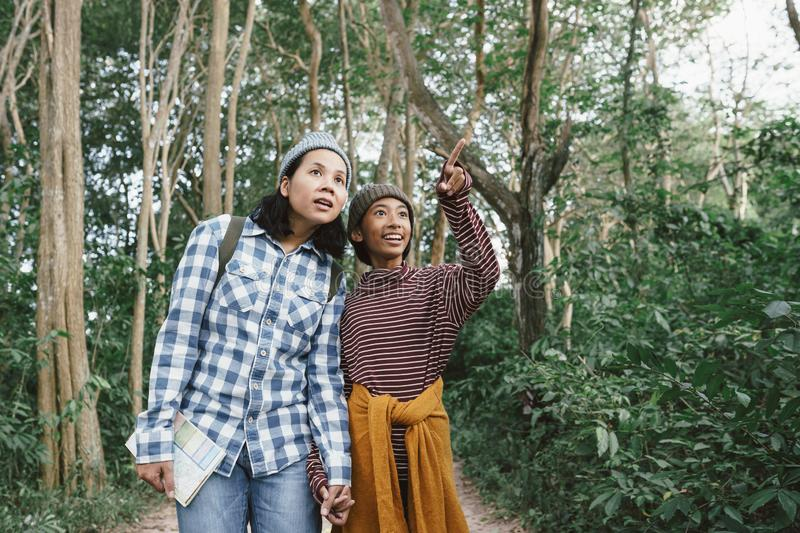 Asian family with a mother and daughter traveling to study the natural path.The concept of  family  tourism holiday lifestyle royalty free stock photography