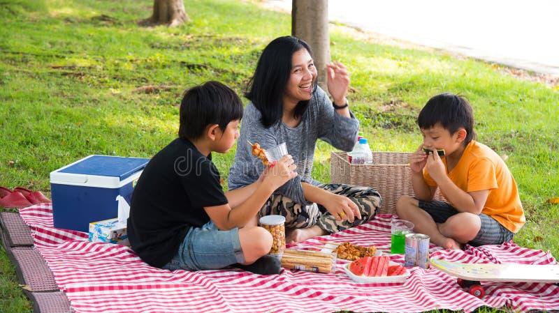 Asian family picnic royalty free stock photography
