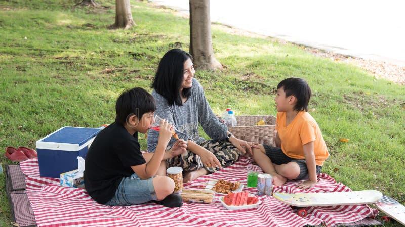 Asian family picnic stock photos