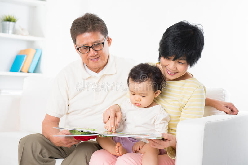 Asian family reading royalty free stock image