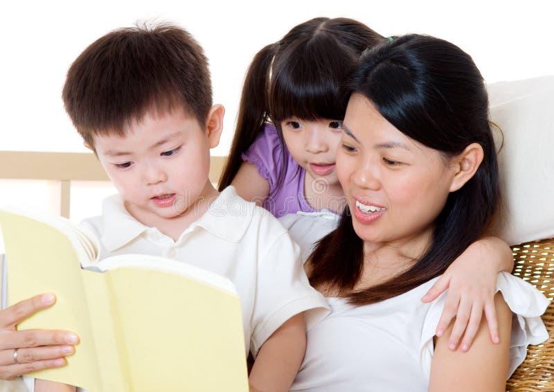 Asian family reading stock photo