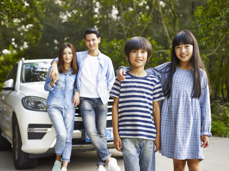 Asian family on the road stock photo